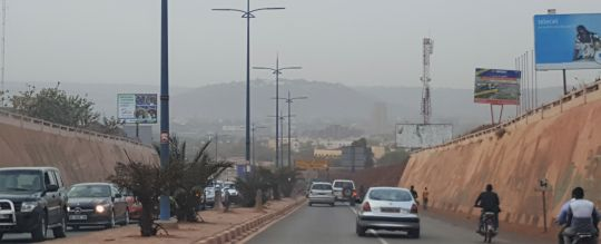 Driving down toward the Niger. On the hill in the hazy background you can spy the presidential palace