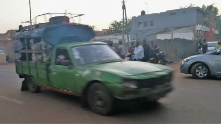 Yes, this blurry green wreck of a car speeding by also poses as taxi bus...